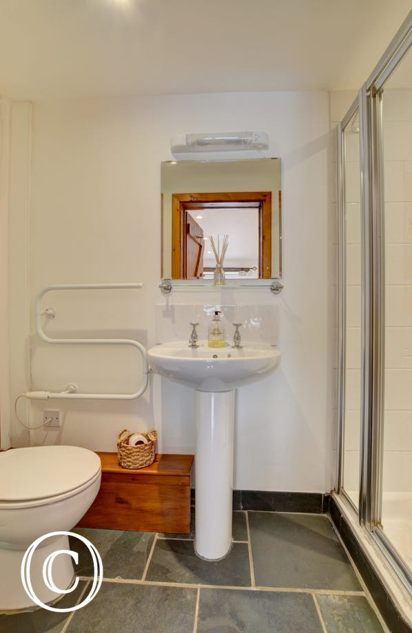 White ensuite bathroom with shower