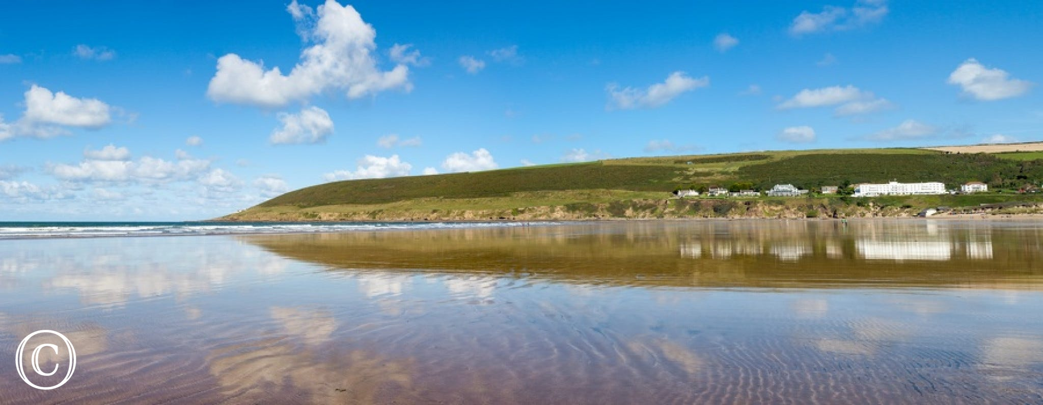 Stunning Saunton from the beach looking up to the apartment on the cliff top