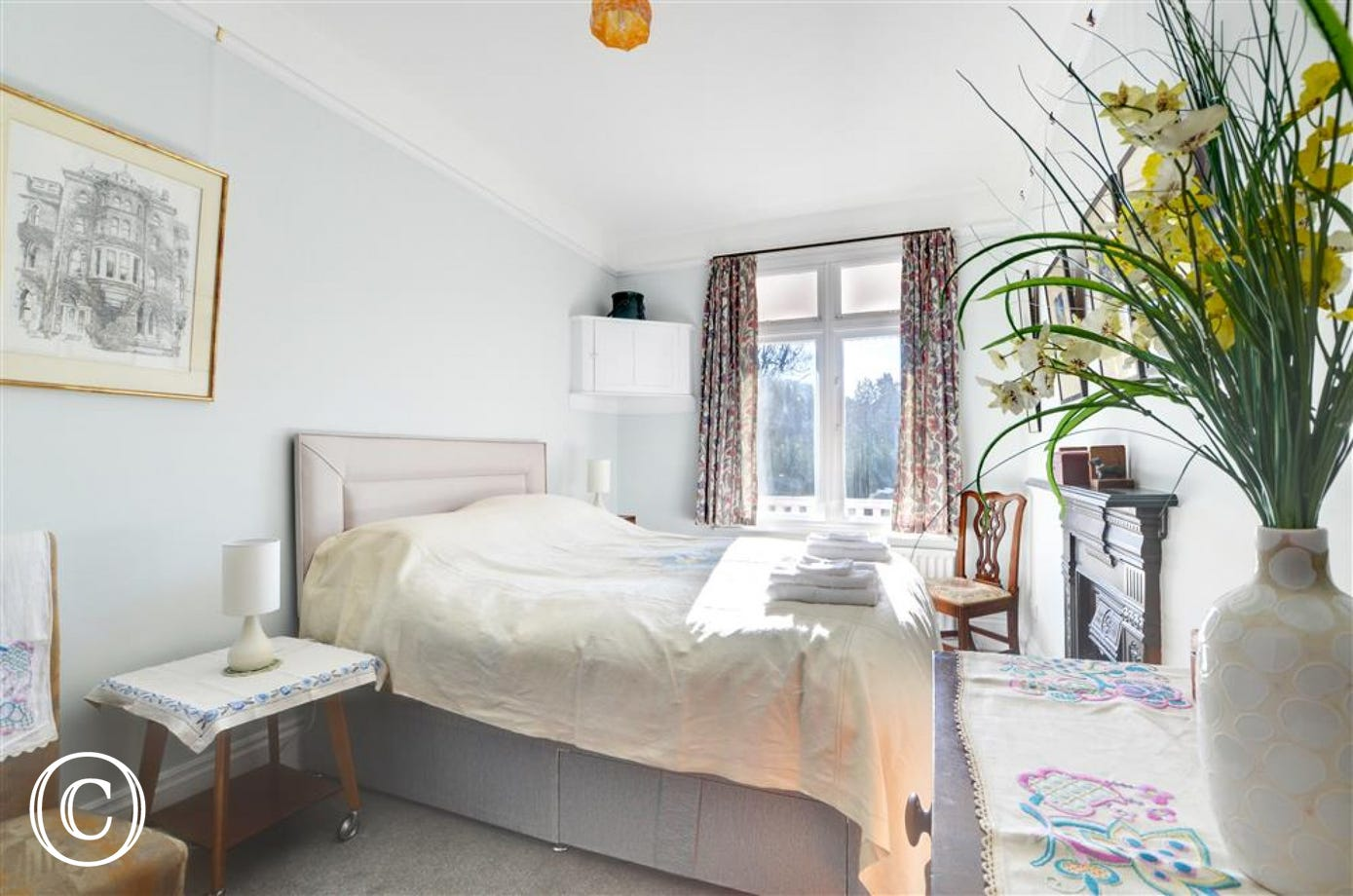Bright and airy king size bedroom