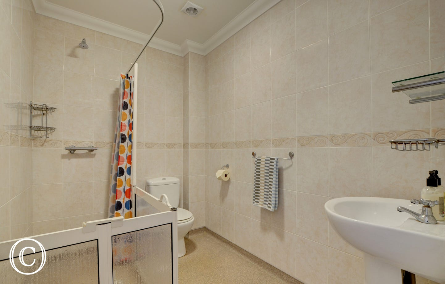 A good sized wet room provides a large level access to power shower in gated enclosure