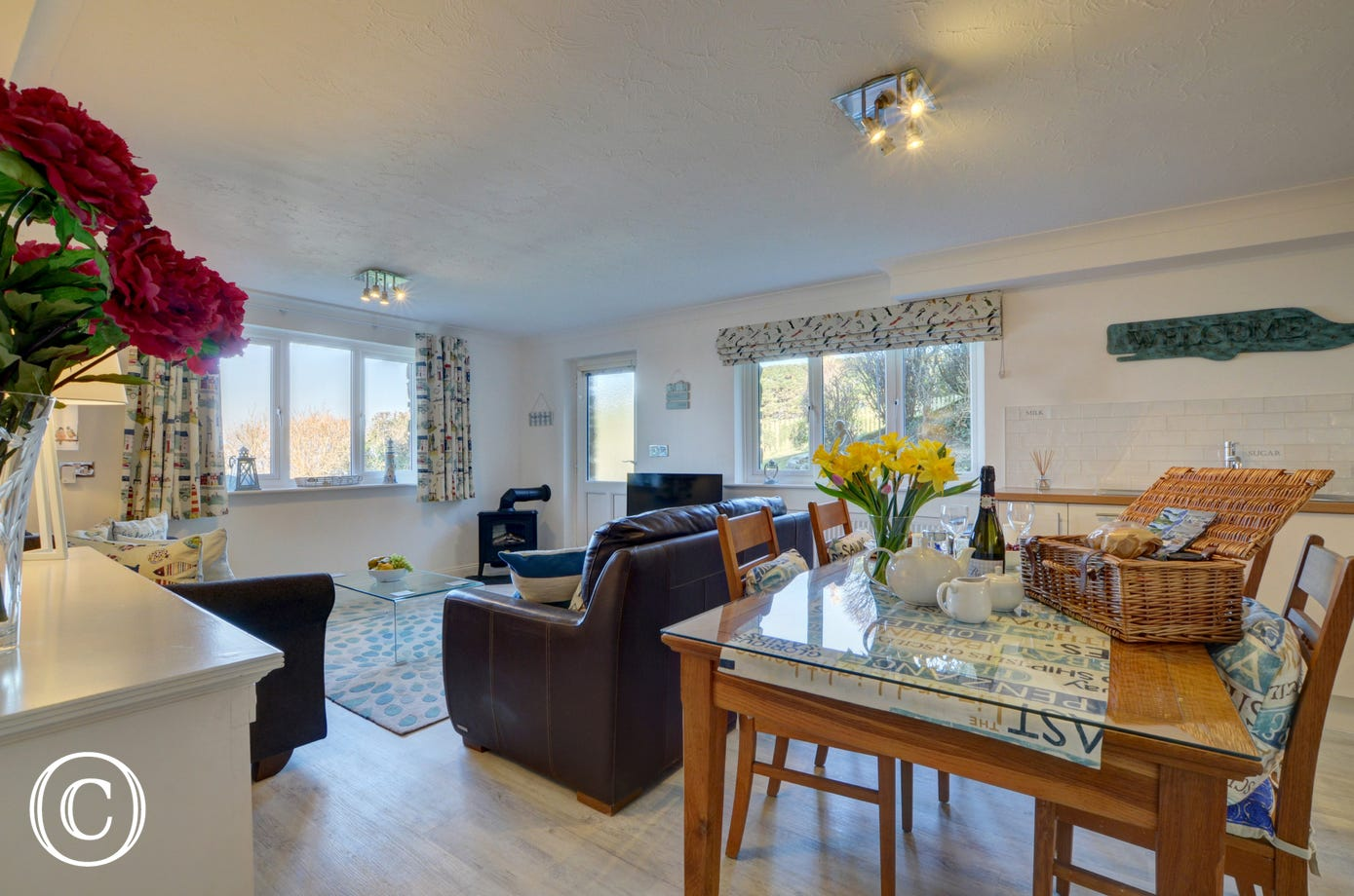 The living area is bright and spacious and has everything you need for an enjoyable stay