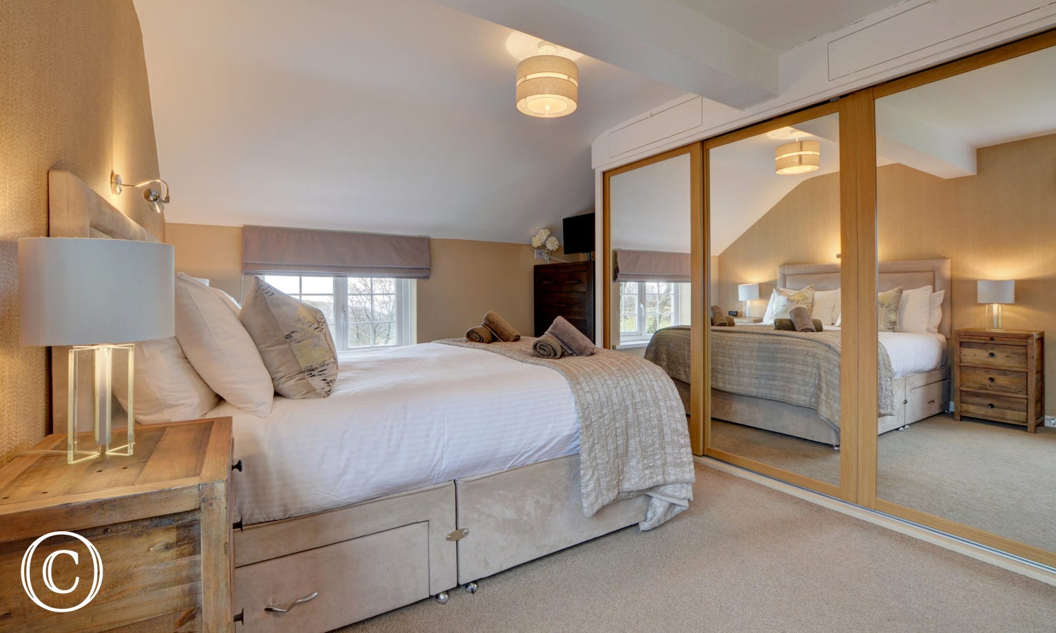 The master bedroom has a very comfortable bed and TV as well as an ensuite bathroom