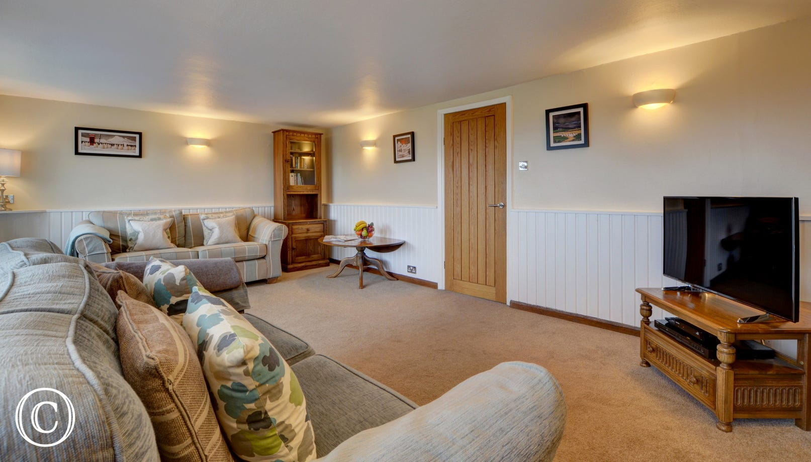 The good sized and very comfortable lounge has two large sofas and there is a woodburning stove for those cooler seasons