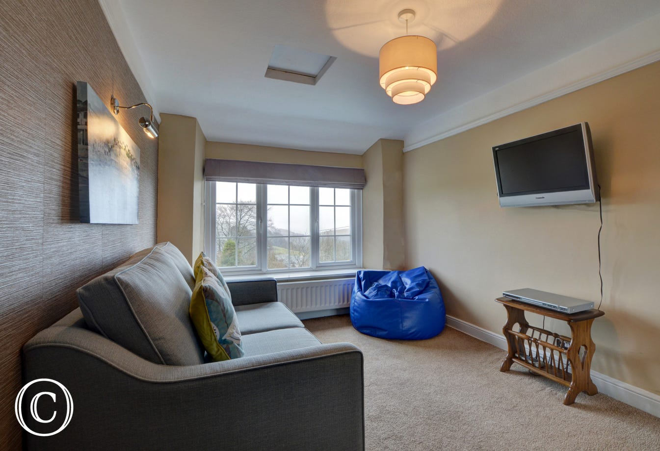 A Snug on the first floor is ideal for quiet relaxation or as a den for the younger generation