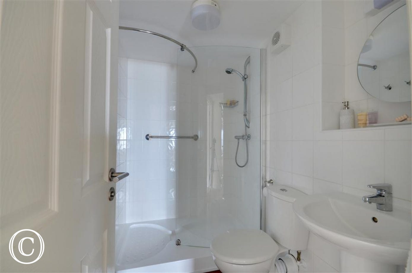Both bedrooms are served by a family shower room with large walk in shower