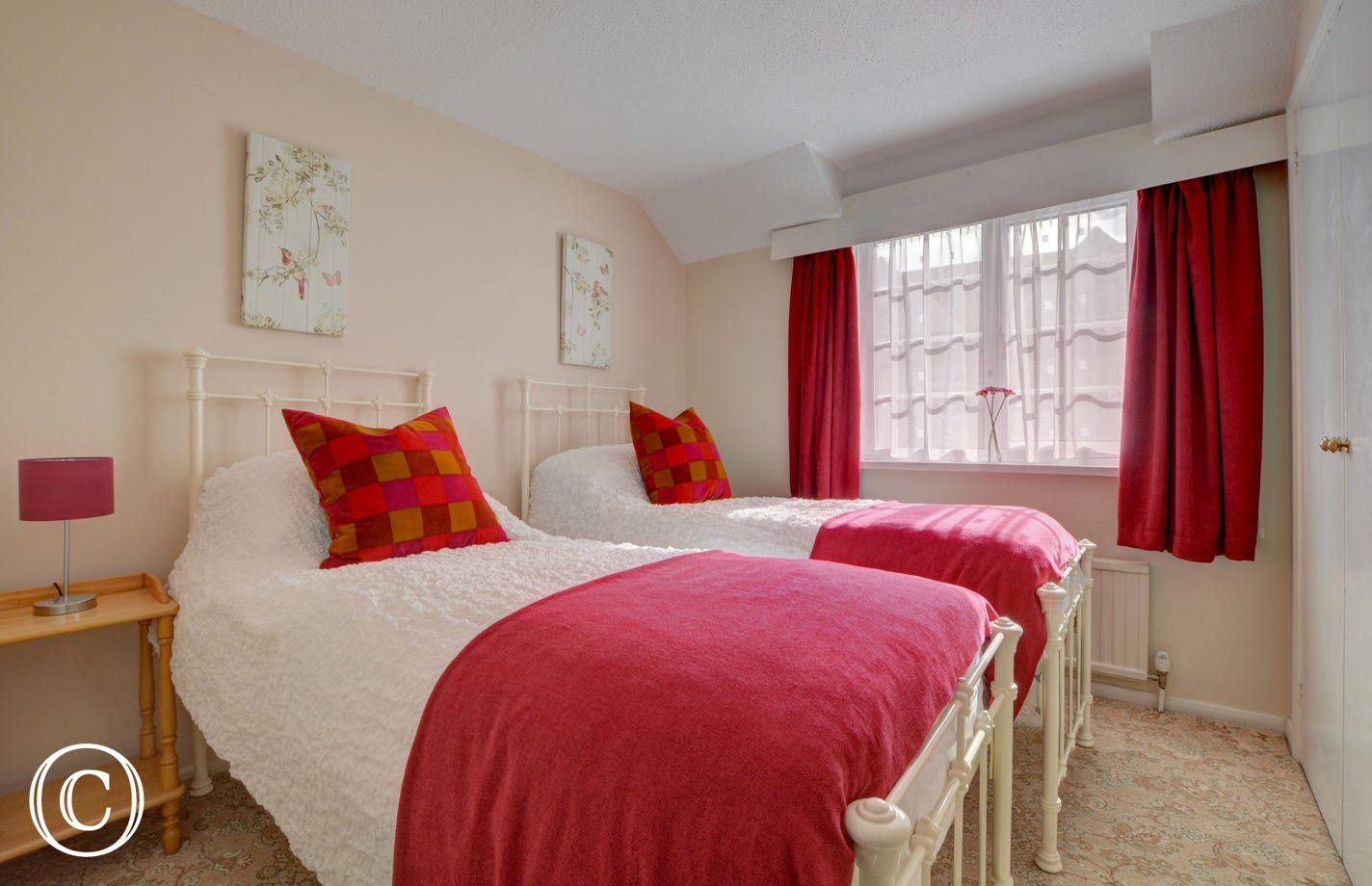 The twin bedroom is bright and cheerful, and on request can be made into a double bedroom