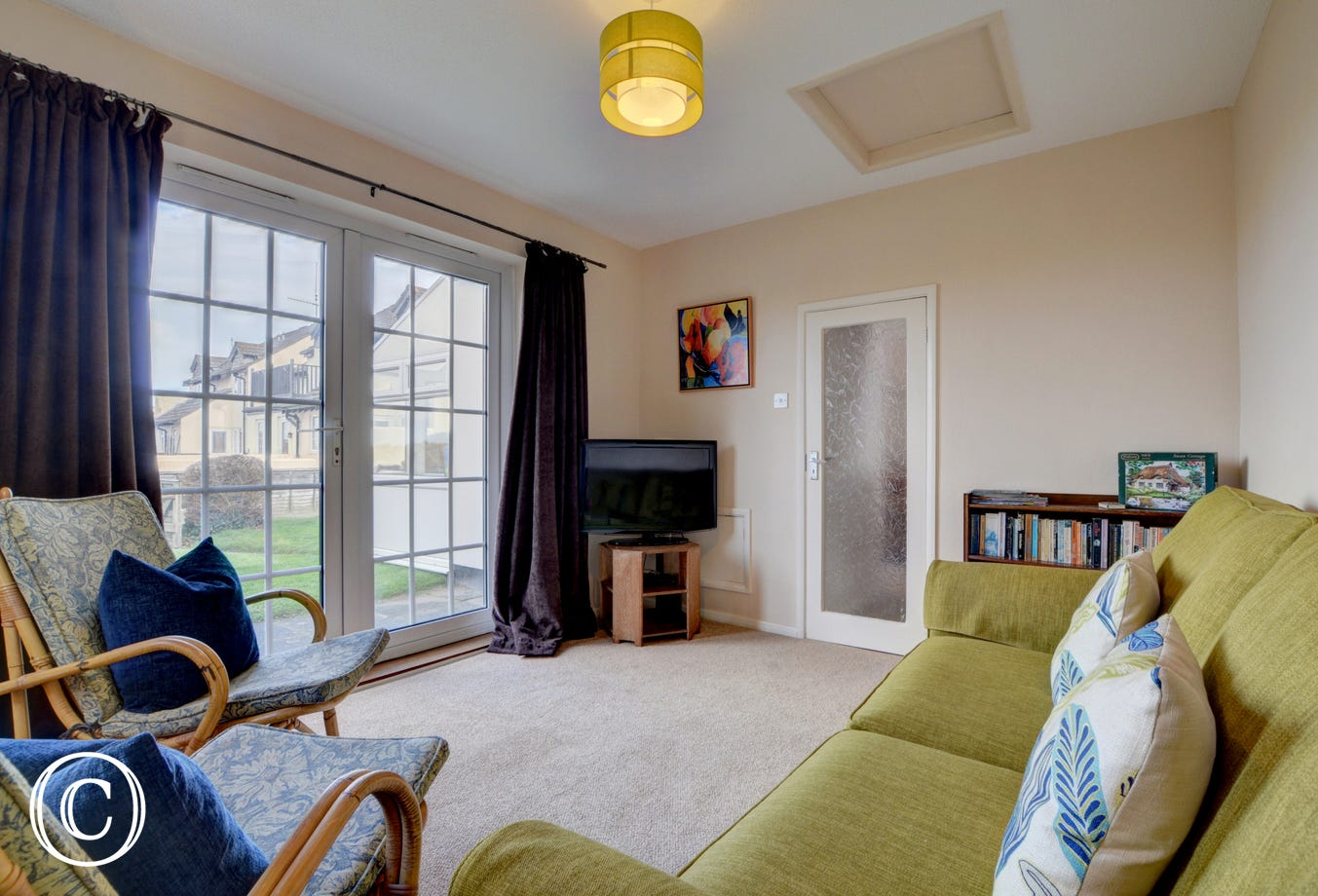 The second sitting room has patio doors that open onto the enclosed garden
