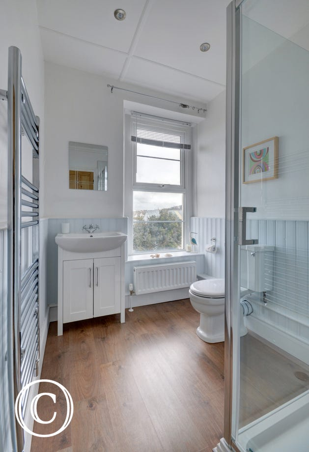 Spacious shower room with WC and basin