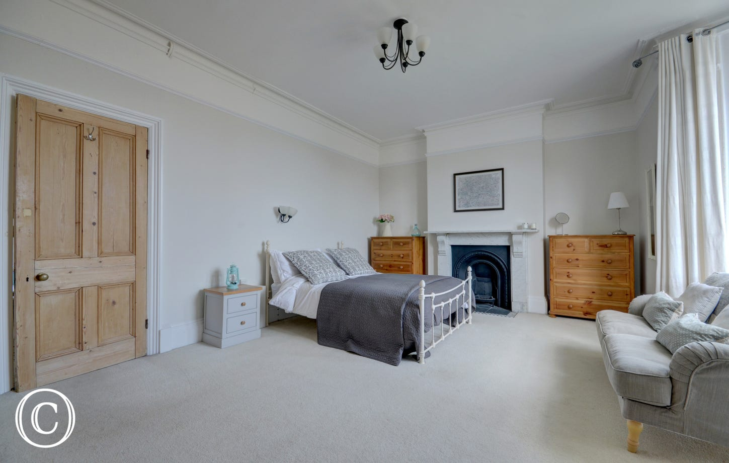 The spacious master king bedded room can be found on the first floor, with sofa in a large bay window and distant sea views across the burrows