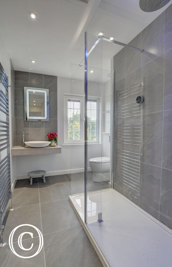 The family shower room with large walk-in shower