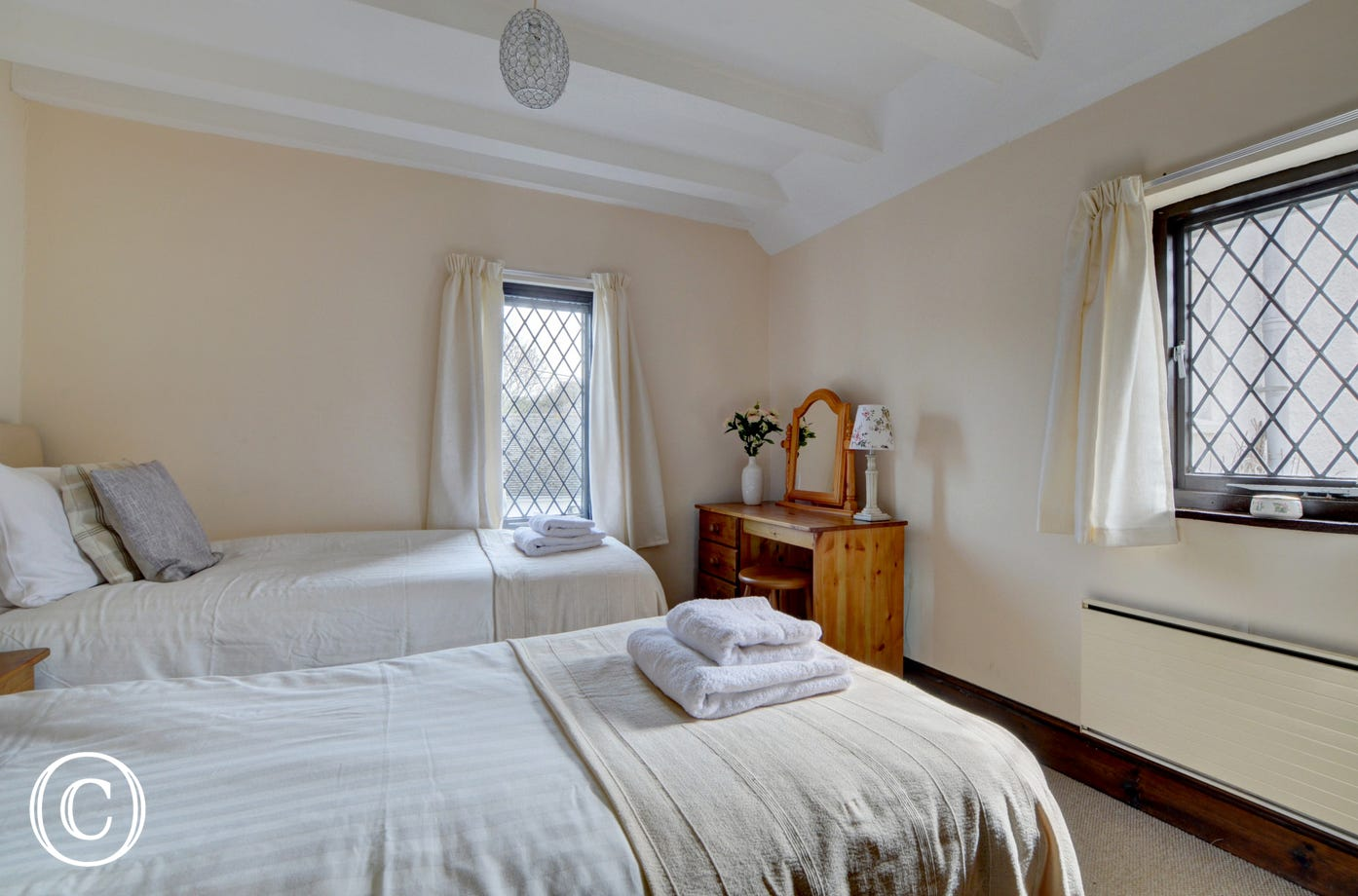 The twin bedroom is decorated in calming colours