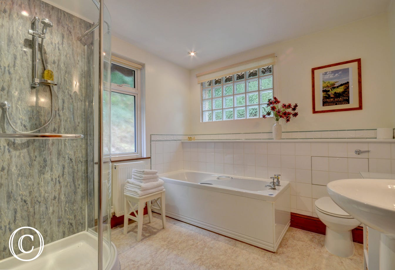 Spacious ensuite bathroom with bath and walk-in shower