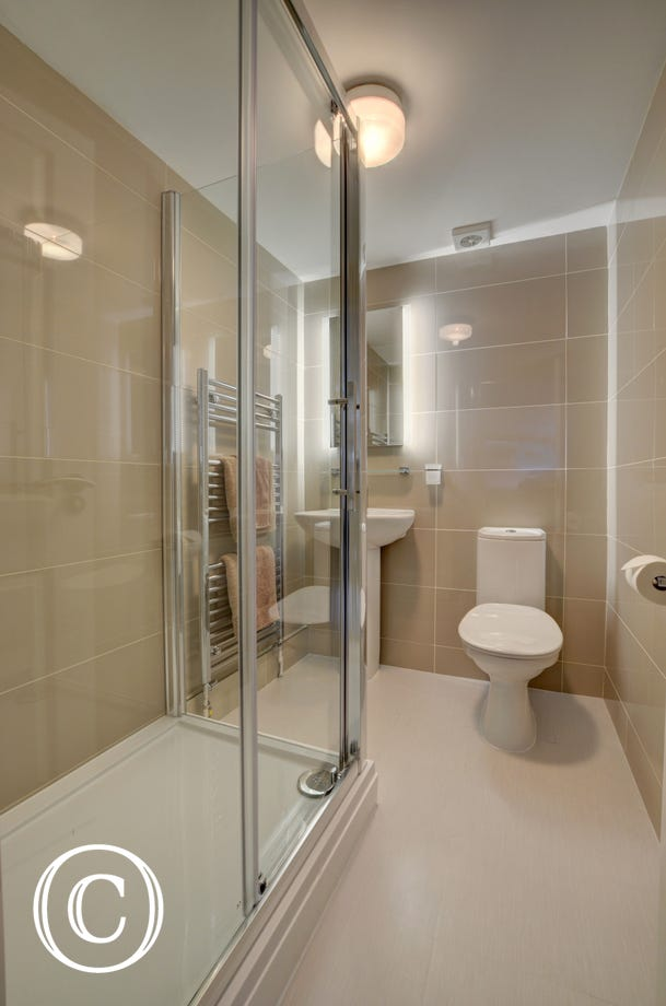 The contemporary ensuite bathroom with huge walk in shower