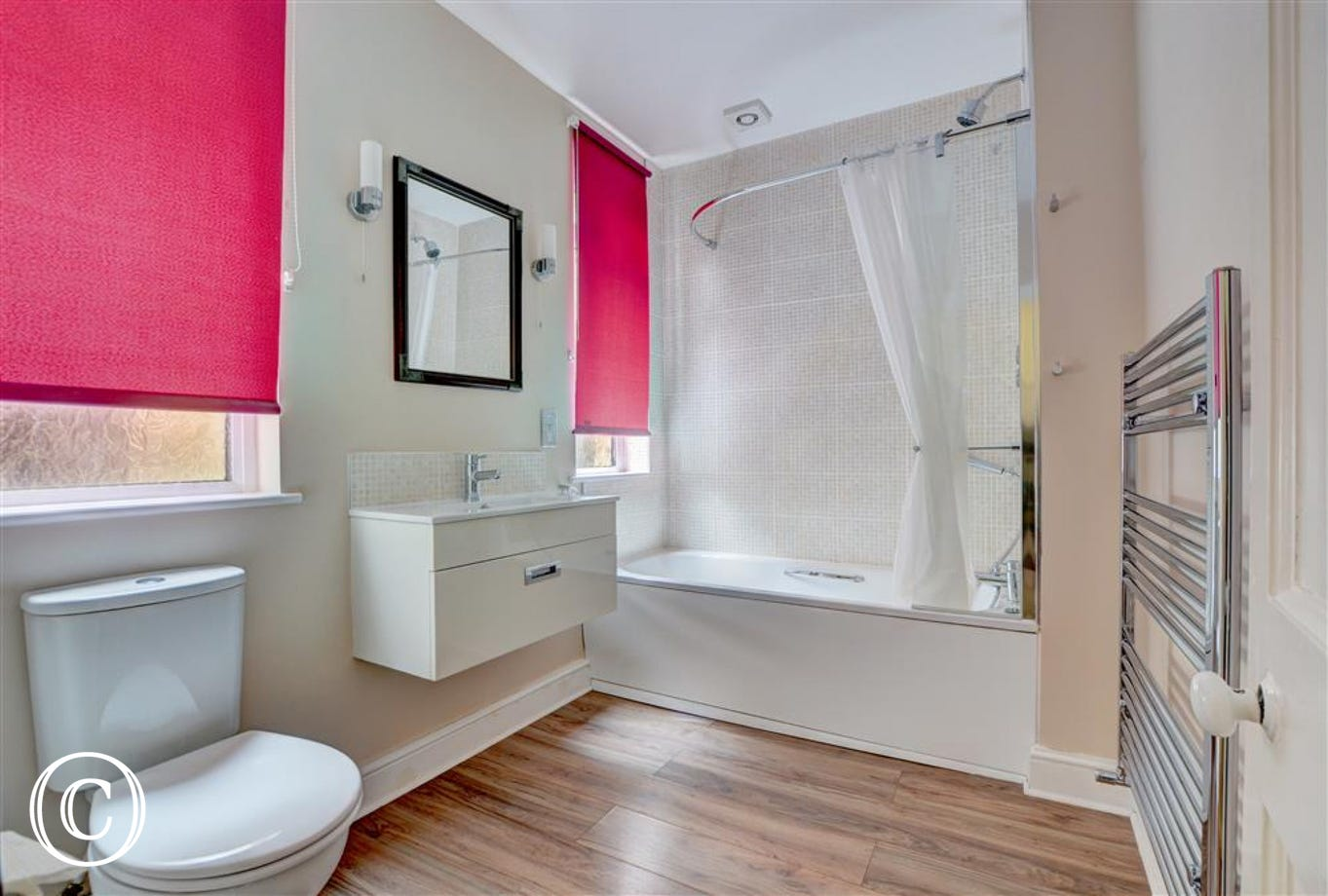 Spacious bathroom with brightly coloured blinds