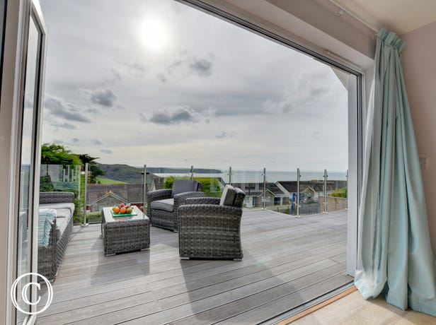 Bi-folding doors open from the lounge to the terrace