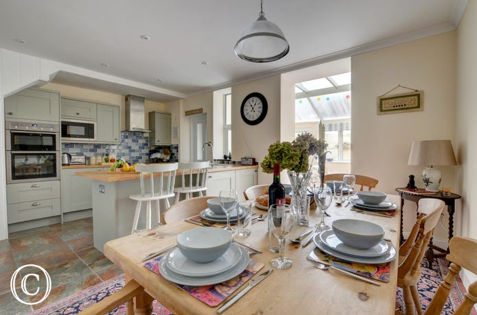 A stylish country feel to this spacious kitchen and dining room