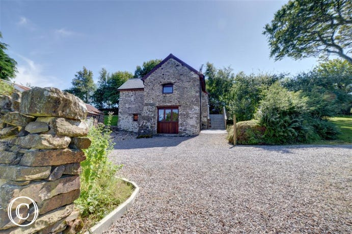 Peacefully located amid spectacular countryside, this detached barn conversion cottage has been newly renovated to high standards throughout