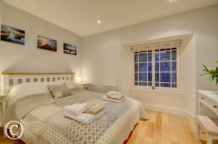 Beautifully decorated master bedroom with ensuite bathroom