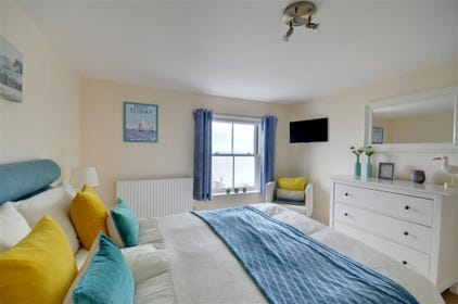Bedroom 1 with King, wall mounted TV and views of the harbour