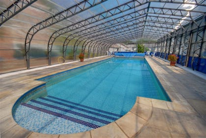 Enjoy a swim in the heated covered swimming pool