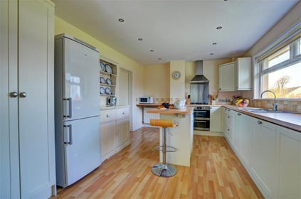 High quality fully fitted kitchen with a picture window and views over the garden