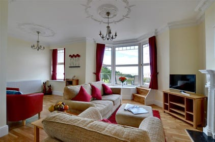 The sitting room has wonderful views from the bay window