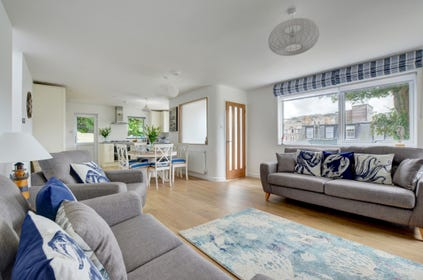 A beautiful seaside themed open plan living and dining area