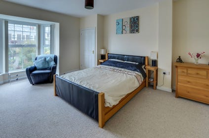 Spacious master bedroom with kingsize bed and ensuite bathroom