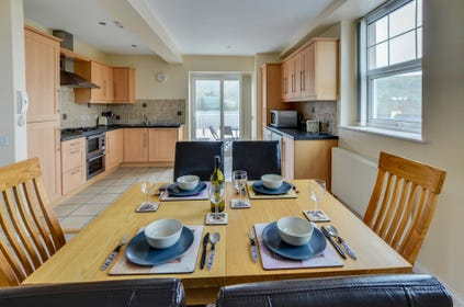 Stylishly presented kitchen and dining area