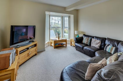 Comfortable seating to relax in and large TV, perfect for watching a good film on