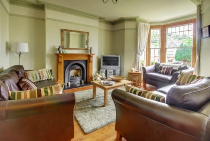 Traditional style Victorian sitting room with wonderful open fire, perfect on cooler evenings