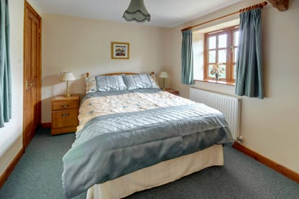 Comfortable double bedroom with plenty of storage for clothes
