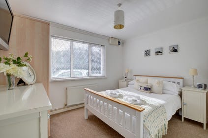Stylishly decorated master bedroom with ample wardrobe space
