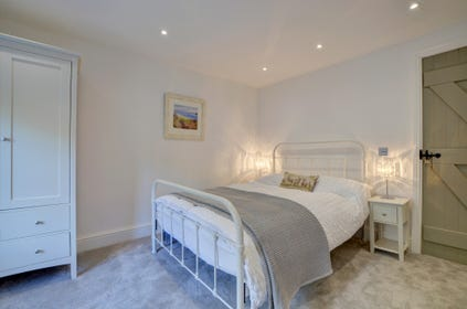 Elegantly decorated master bedroom which has lovely river views